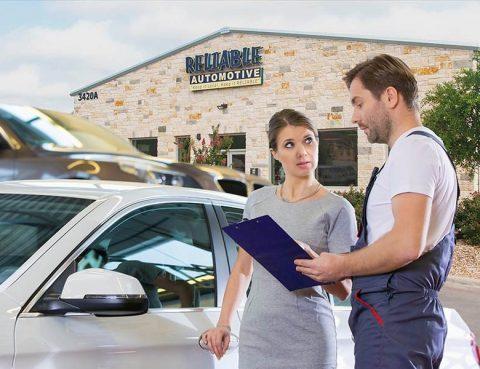Woman talking to mechanic outside Reliable Automotive